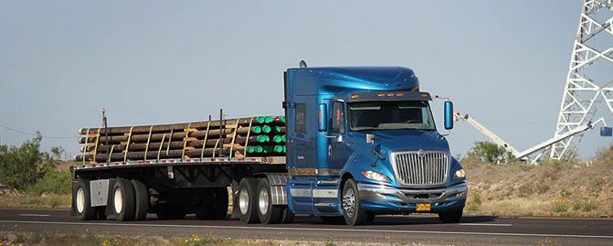 18 Wheeler hauling Drill Pipe